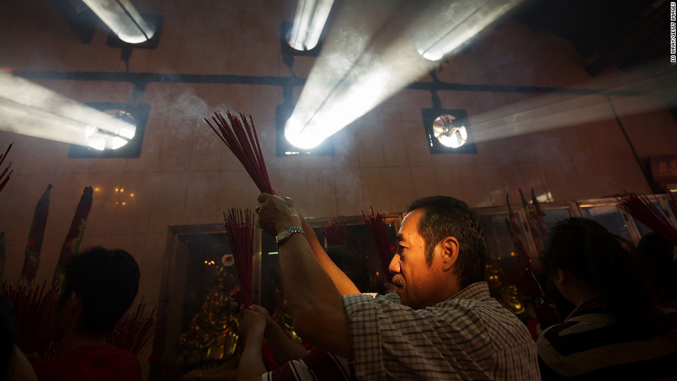 An Indonesian man of Chinese descent prays in the Vihara Dharma Bhakti temple in Jakarta, Indonesia on February 10.