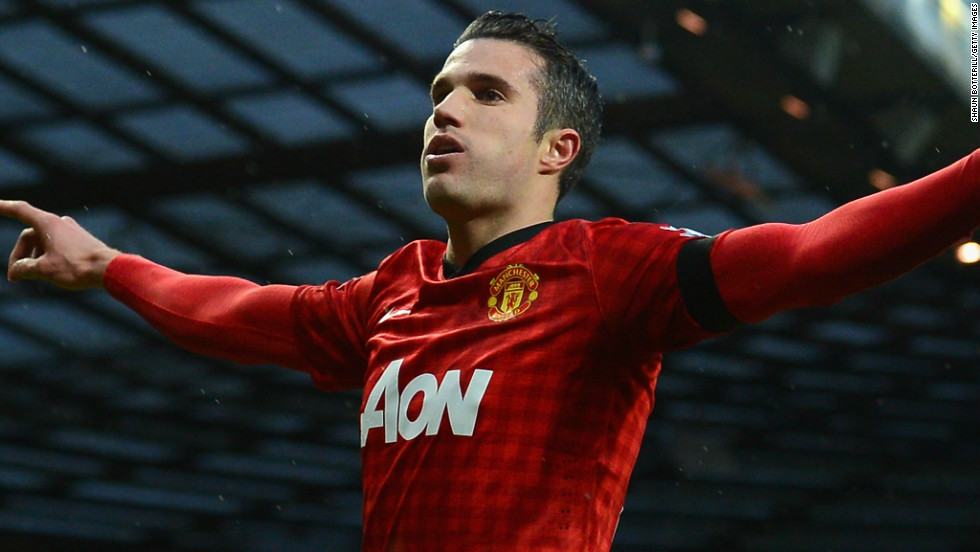 Robin van Persie celebrates after scoring Manchester United's second goal in the 2-0 win at home to Everton, which put his team 12 points clear in the English Premier League.