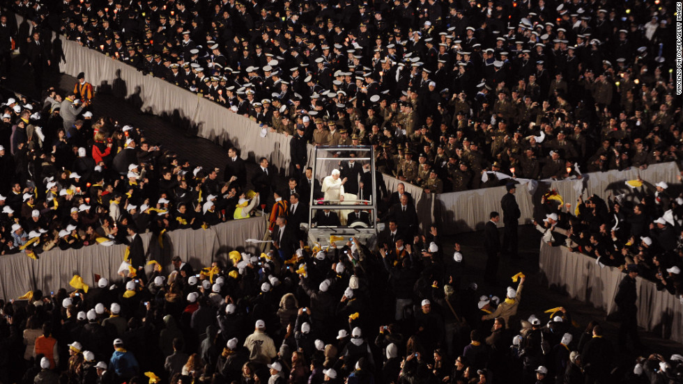 Benedict blesses pilgrims as he arrives in St. Peter's Square in his popemobile in March 2010 to meet with young people from Rome and the Lazio region in preparation for World Youth Day.