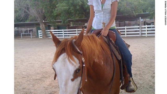 Pearce on horseback, one of her favorite pastimes.
