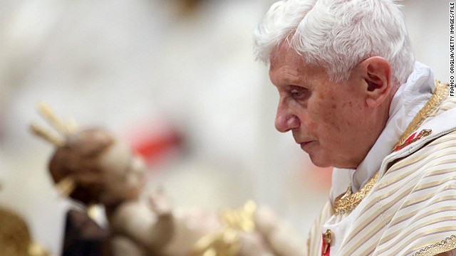 Pope Benedict XVI walks in front the crib as he attends the Christmas night mass at the St. Peter's Basilica on December 24, 2012 in Vatican City.