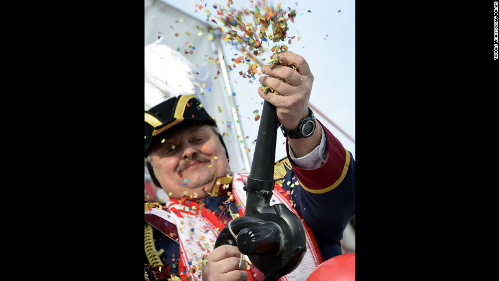 A man shoots confetti in the air at the carnival in Herbstein.
