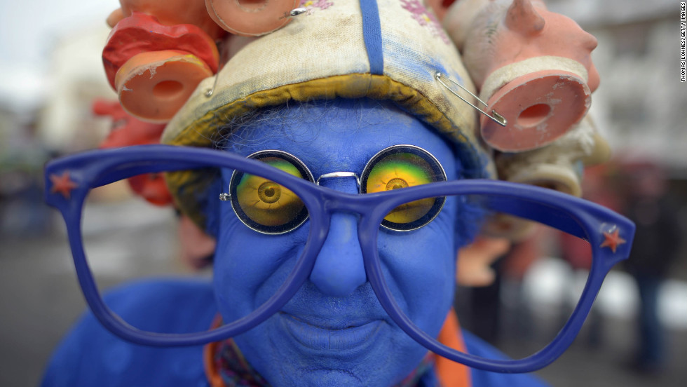 "A blue attendee shows off his costume at the Springerzug carnival parade in Herbstein, Germany. The Springerzug, literally ""jumping parade,"" is an interpretation of carnival tradition particular to Herbstein."