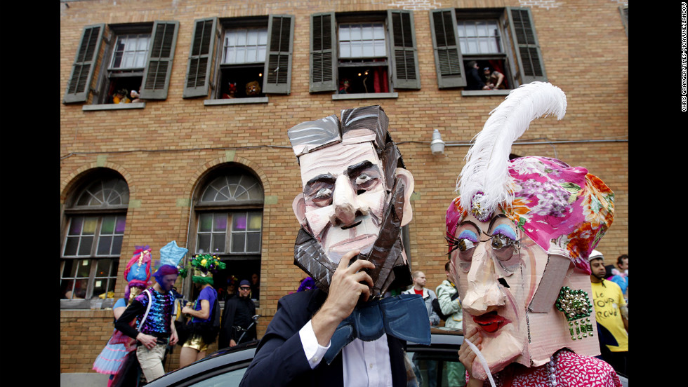 """Nick Mahshie and Anne Devalence, dressed as """"Abe Lincoln and his mistress,"""" participate in Mardi Gras celebrations in the Faubourg Marigny."""