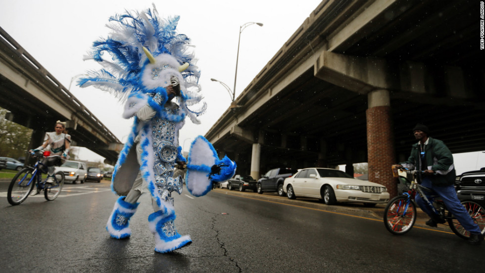 Flag boy Leroy Ross of the Wild of the Nation Mardi Gras Indians crosses Claiborne Avenue in New Orleans.