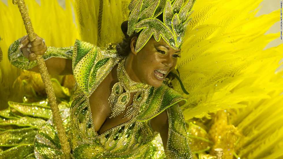 More than 500,000 foreign visitors flock to the carnival each year to dance, shout, drink and surge around in happy mobs, watching dancers like this one of Vila Isabel samba school.