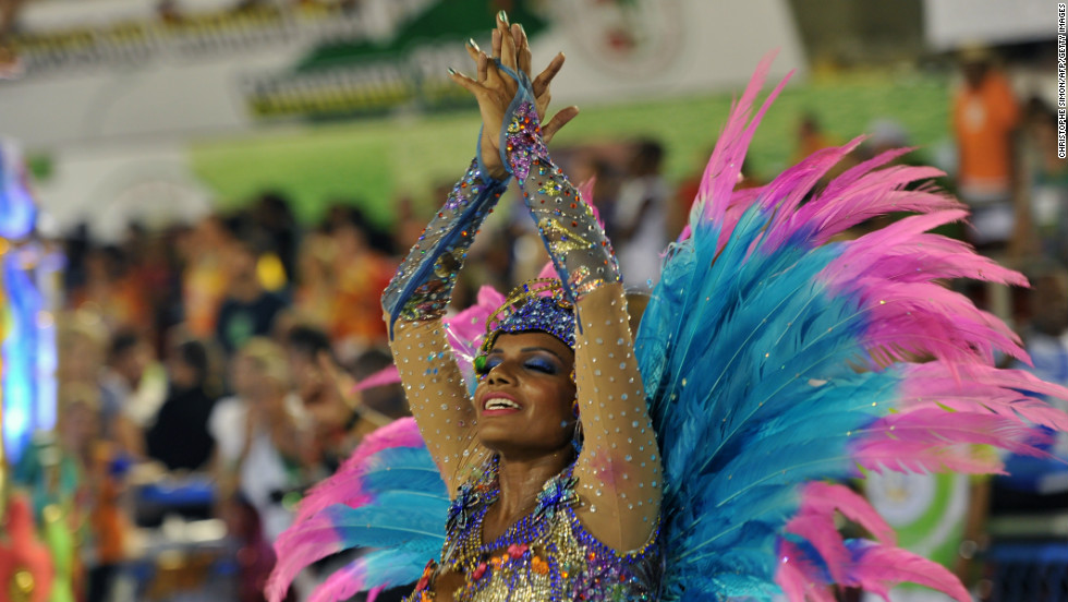 Brazil's annual Carnival is a four-day festival that takes place just before Lent. Pictured here, a reveler of Vila Isabel samba school.
