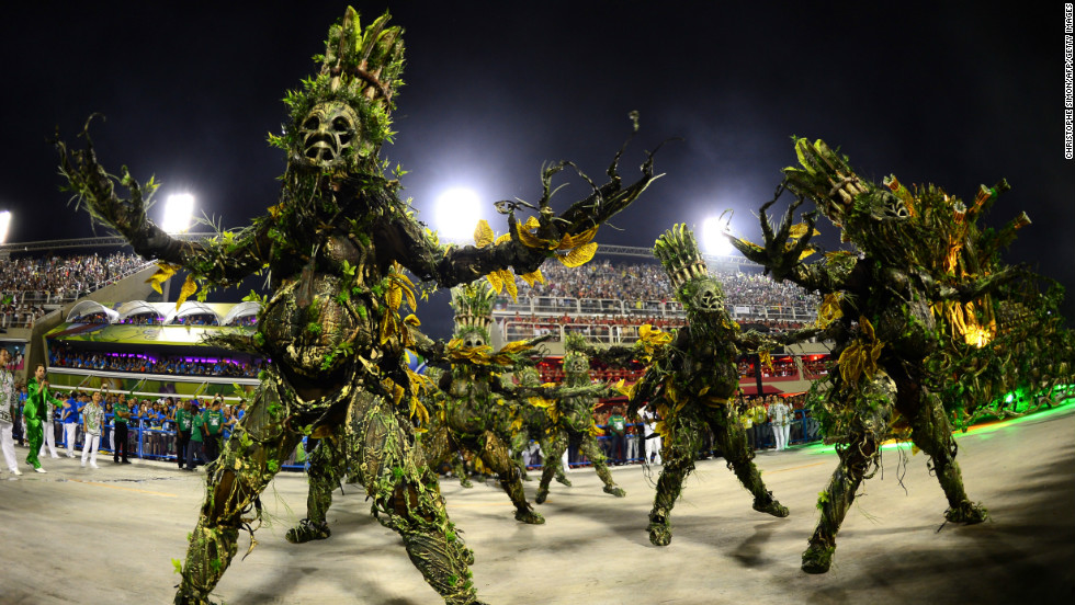 Imperatriz Leopoldinense samba school perform wearing elaborate costumes during Carnival parades at the Sambadrome.