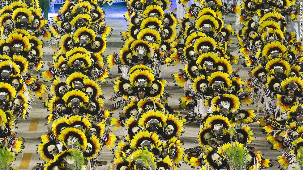 Approximately 3,000 to 5,000 members of each school participate in full-blown costumes that differ every year. Pictured here are members of Imperatriz Leopoldinense samba school.