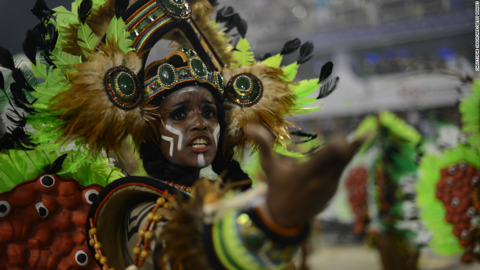 A reveler of Imperatriz Leopoldinense samba school performs during the second night of Carnival parades at the Sambadrome in Rio de Janeiro on February 12, 2013.