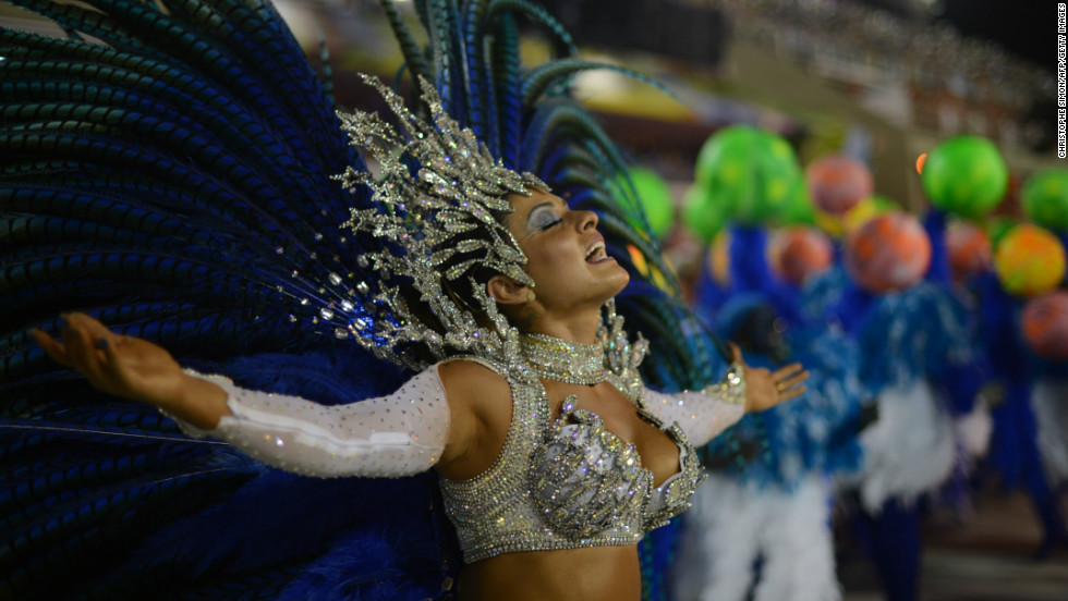 Pounding drums and fireworks explosions announce the start of each samba school that parades down the emblematic strip -- in this case the Vila Isabel samba school.