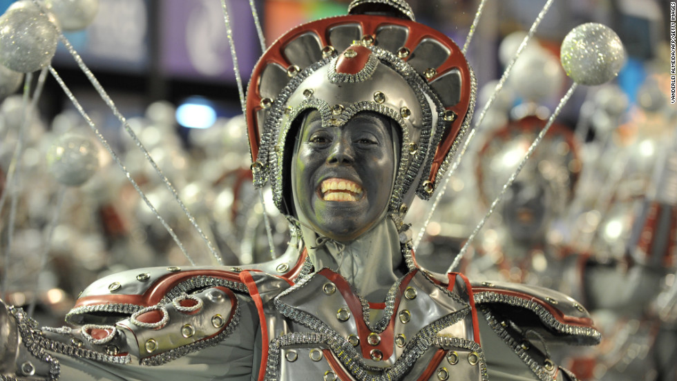 "Like something out of the 1980 film ""Flash Gordon,"" this performer from the Unidos da Tijuca samba school shows off the pearly whites. This samba school is the defending champion."