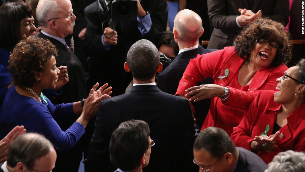 Obama greets members of Congress before the address.