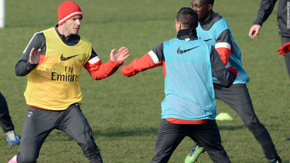 Beckham, 37, was put through is paces at the club's open training day where more than 100 journalists turned up to witness the event. The former Manchester United and Real Madrid star is hoping to make his debut against Sochaux on Sunday, but it's not known if his pop star wife Victoria will be in attendance. Beckham's family has remained in London where his children Brooklyn, Romeo and Cruz attend school following their move from Los Angeles.
