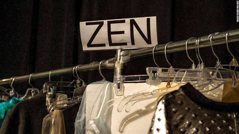 A model's nametag hangs above a clothing rack backstage on February 13.