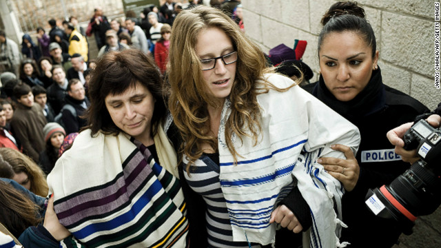 Israeli police arrest American Rabbi Susan Silverman (L), sister of comedian Sarah Silverman, and her teenage daughter Hallel Abramowitz (C), after performing Rosh Hodesh prayers at the Western Wall in Jerusalem, on February 11, 2013. The prayer was organized by the Women of Wall, a group which calls for rights of women to pray at Judaism's holiest site without restriction. AFP PHOTO/JANOS CHIALA (Photo credit should read Janos Chiala/AFP/Getty Images)
