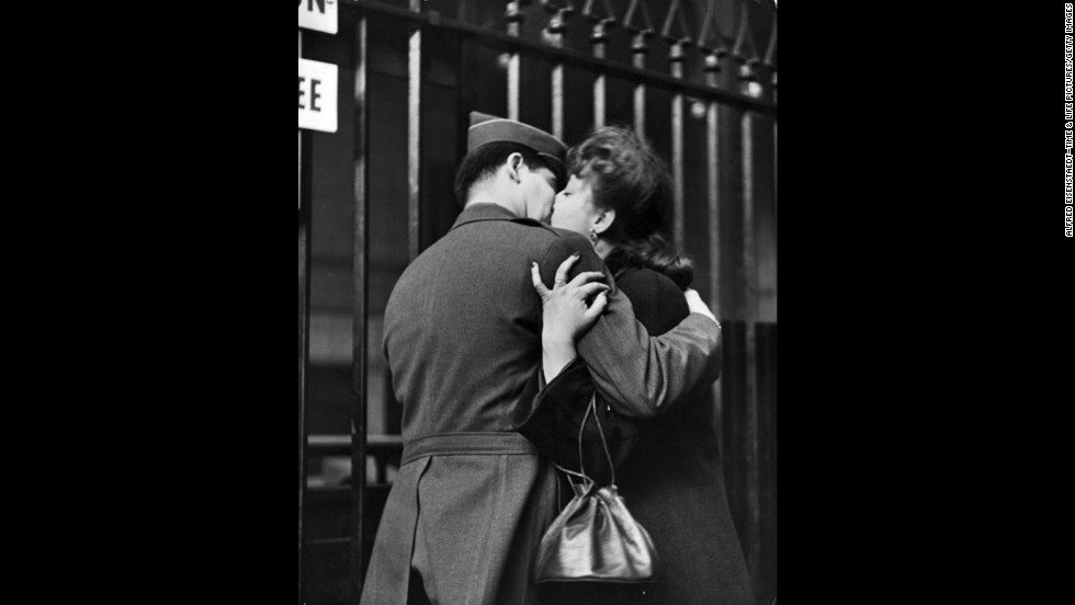 "A woman grasps her loved one as they kiss goodbye. <a href=""http://life.time.com/history/true-romance-the-heartache-of-wartime-farewells-penn-station-1943/#1"" target=""_blank"">See more photos at Life.com</a>."
