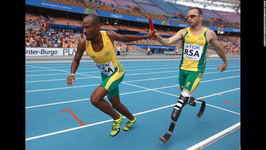 Pistorius passes the baton to Ofentse Mogawane in a 4x400-meter relay race during the IAAF World Athletics Championships in Daegu, South Korea, in September 2011. Pistorius was the first double-amputee athlete to compete at the World Athletics Championships.