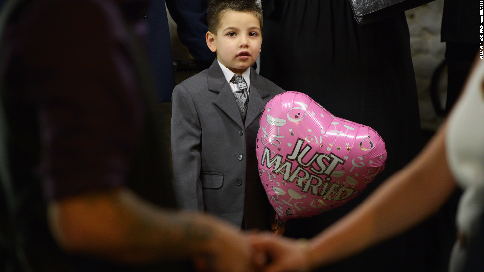 A boy holds a balloon as he attends a wedding at Gretna Green in Dumfries and Galloway, Scotland. Gretna Green has been hosting weddings since 1754 and is a popular destination for Valentine's Day weddings.