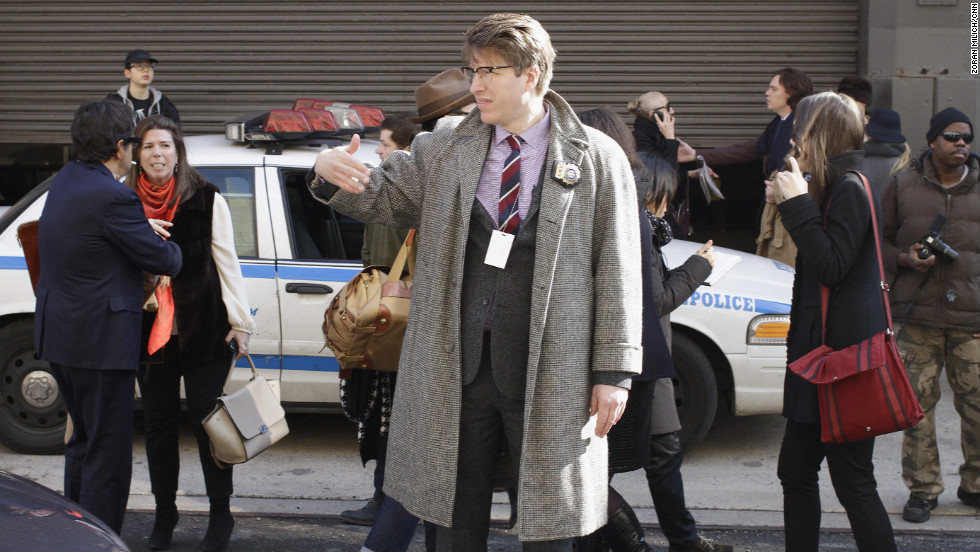 "NYPD community affairs detective Rick Lee, also known as the ""Hipster Cop,"" directs traffic."