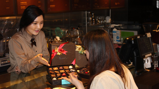 Buying handmade chocolate at Jubilee Chocolatier in Seoul.