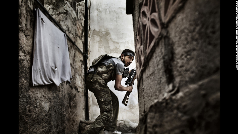 <strong>Second prize -- spot news stories: </strong><br />A Free Syrian Army fighter during clashes against government forces in Aleppo, Syria, on October 10, 2012.