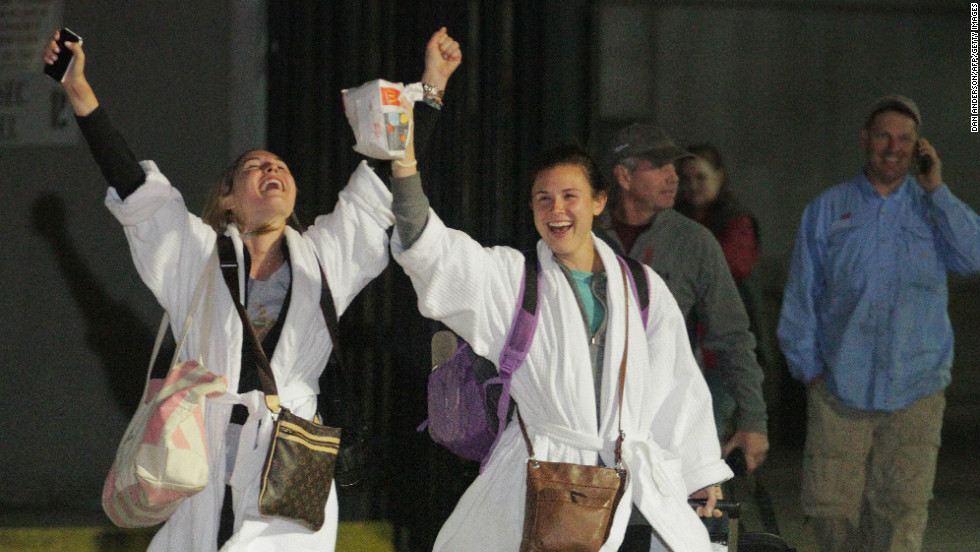 Passengers cheer after stepping off the crippled cruise ship. The last ones got off early Friday, February 15.