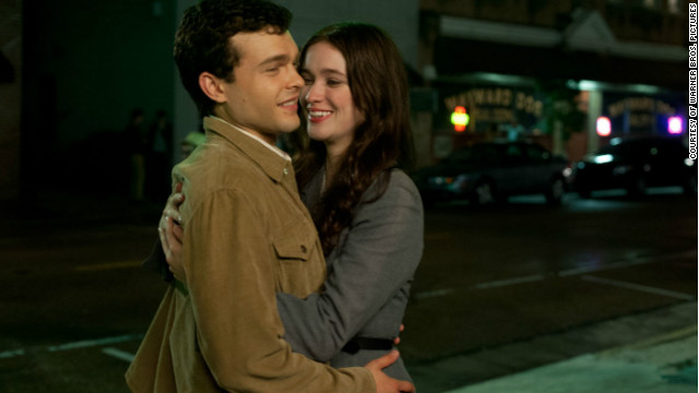 "Alden Ehrenreich stars as Ethan Wate and Alice Englert stars as Lena Duchaness in ""Beautiful Creatures."""