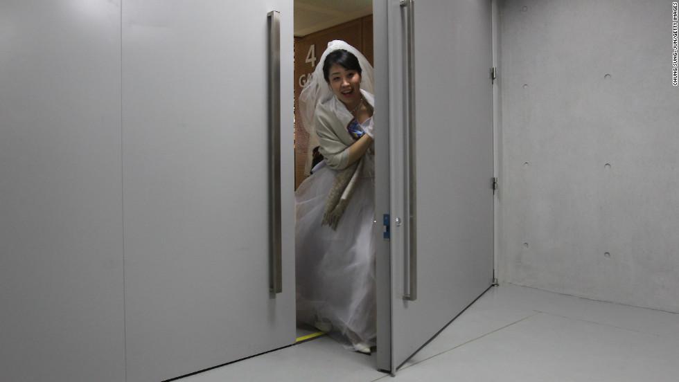 A bride passes through a door at the center.