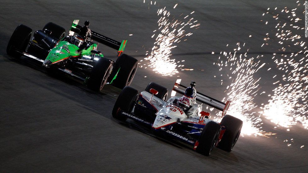 "Patrick, left, drives next to Dan Wheldon during practice for the Cafes do Brasil Indy 300 in 2010 in Homestead, Florida. <a href=""http://www.cnn.com/2011/10/16/us/indycar-crash"">(Wheldon died in 2011 at the Las Vegas Indy 300).</a>"