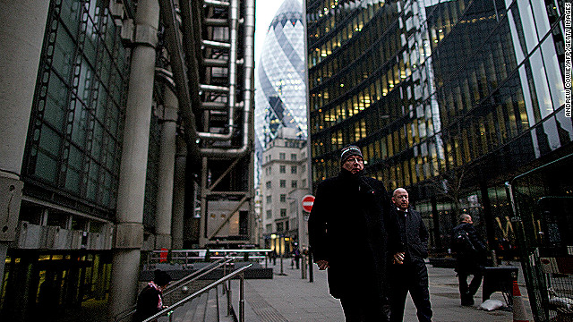 City workers leave their offices on January 25, as Britain's economy was reported to have shrank 0.3 percent in Q4 2012.