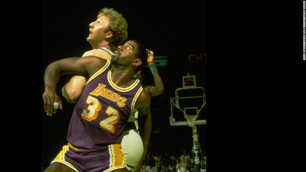 "After the Lakers' first championship under Buss, either the Lakers or Boston Celtics played in the next four championship series. The Celtics won the 1984 championship in seven games, reigniting a storied rivalry between the two teams that had waned after the championship contests of the 1960s. Pictured, ""Magic"" Johnson and the Boston Celtics' Larry Bird in the NBA Finals in 1984."