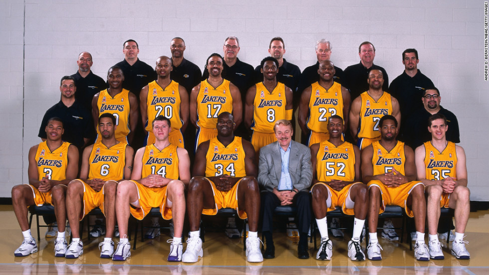 Not only did Buss' Lakers win their third-straight championship, but his Sparks racked up their second consecutive title. Pictured, the Lakers' team portrait in 2002.