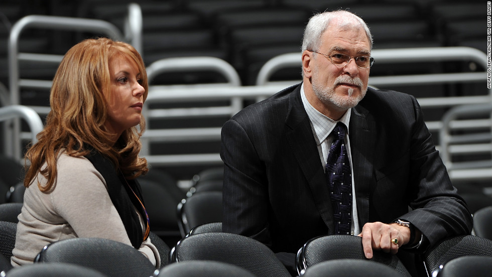Daughter Jeanie Buss, executive vice president of business operations for the Lakers, got engaged to Lakers' head coach Phil Jackson, the architect of five of the team's championships, in 2012. Pictured, the two watch a game together in 2007.