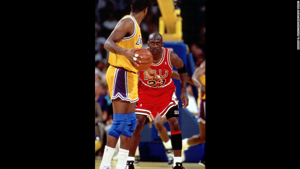 "Buss' Lakers got their last whiff of a championship during this era, winning the first game of the series before losing to Michael Jordan's Chicago Bulls in four straight games. With Abdul-Jabbar retired, the other Lakers began showing their age. The Lakers didn't make another championship until 2000. Pictured, ""Magic"" Johnson faces off against Jordan in the '91 finals."
