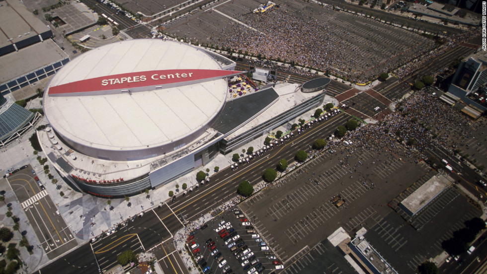 The Lakers and Sparks moved into the $375 million Staples Center in downtown Los Angeles in 1999. Pictured, Lakers fans crowd the center during the Lakers' NBA championship parade in June 2001.