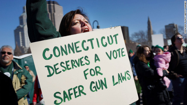 A woman's sign echoes President Obama's address to the nation at a rally for gun control at the Connecticut State Capitol on February 14.