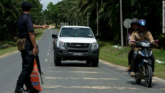 A Malaysian policemen mans a security check in the areas where suspected Philippine militants are located in Borneo on Monday.
