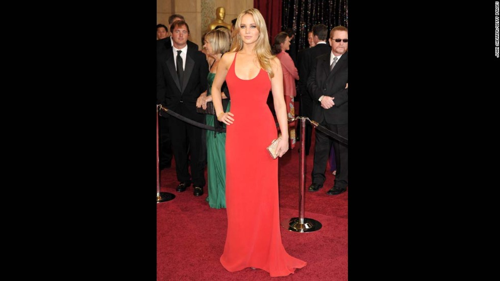 "You know how there was the ""Girl with the Dragon Tattoo"" movie in 2011? At that year's Oscars, Jennifer Lawrence was ""The Girl in the Red Calvin Klein."" Who else but J. Law could wear what is essentially a very long tank top and look this amazing?"