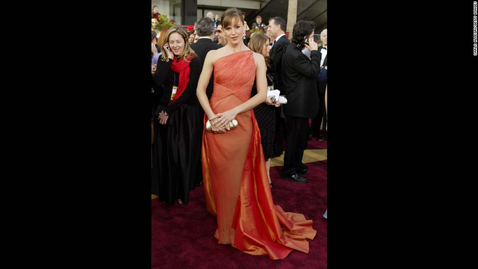 "Before we'd even heard of a Katniss Everdeen, Jennifer Garner was the virtual ""Girl on Fire"" at the 2004 Oscars. On someone else, the burnt-orange Valentino gown -- complete with 15 yards of taffeta -- would've been overwhelming, but Garner pulled it off with ease."