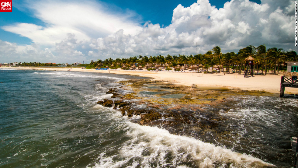 """As Michele Kontaxes Naurock was taking a stroll along a Riviera Maya beach in Mexico, she couldn't resist capturing the sight in front of her: """"the beautiful coastline, the wind ripping through the palm trees and the gorgeous clouds at that moment in time."""""""