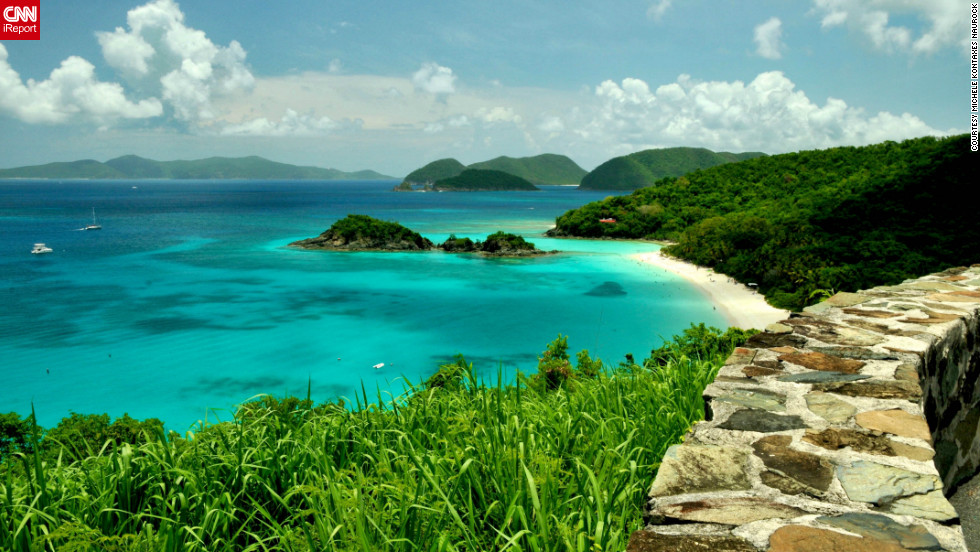"""Trunk Bay in the U.S. Virgin Islands reminds Michele Kontaxes Naurock of her wedding day. She and her spouse celebrate their anniversary by making return trips to this beach. The memories and its """"untouched beauty ... and the beautiful clear blue waters"""" make it a special place to her."""