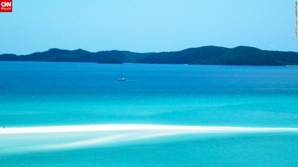 "Luke Schwerdtfeger spent the night on a chartered sailboat, and when he woke up the captain told passengers they were going to ""the finest sand beach in the world."" After hiking through a forested area off the main beach, Schwerdtfeger arrived at a lookout point where he snapped these photos of Whitehaven Beach in Australia."
