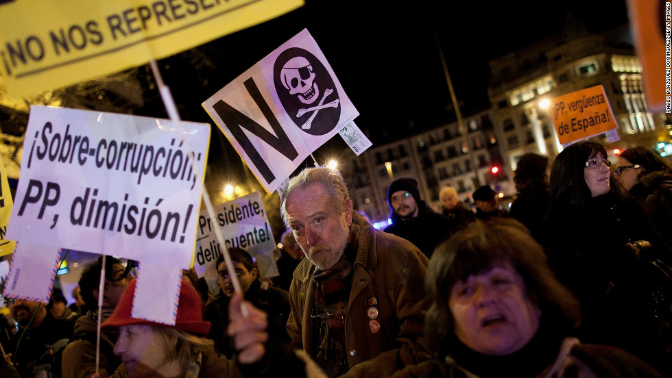 Protestors gather during a demonstration against alleged corruption scandals implicating the PP (Popular Party) on February 3 in Madrid, Spain.