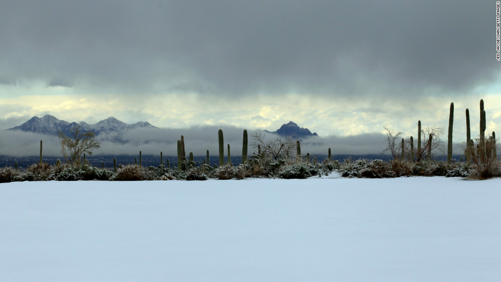 Snow covers the driving range at Dove Mountain on Wednesday.