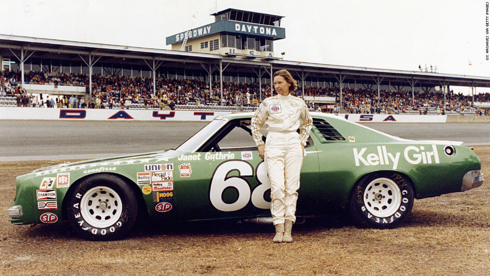 Janet Guthrie stands in front of her car before the Winston Cup Daytona 500 race on February 20, 1977. Later that year she became the first woman to drive in the Indy 500.