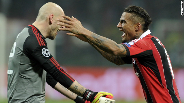Goalkeeper Cristian Abbiati and Kevin-Prince Boateng celebrate Milan's unexpected 2-0 win over the tournament favorites
