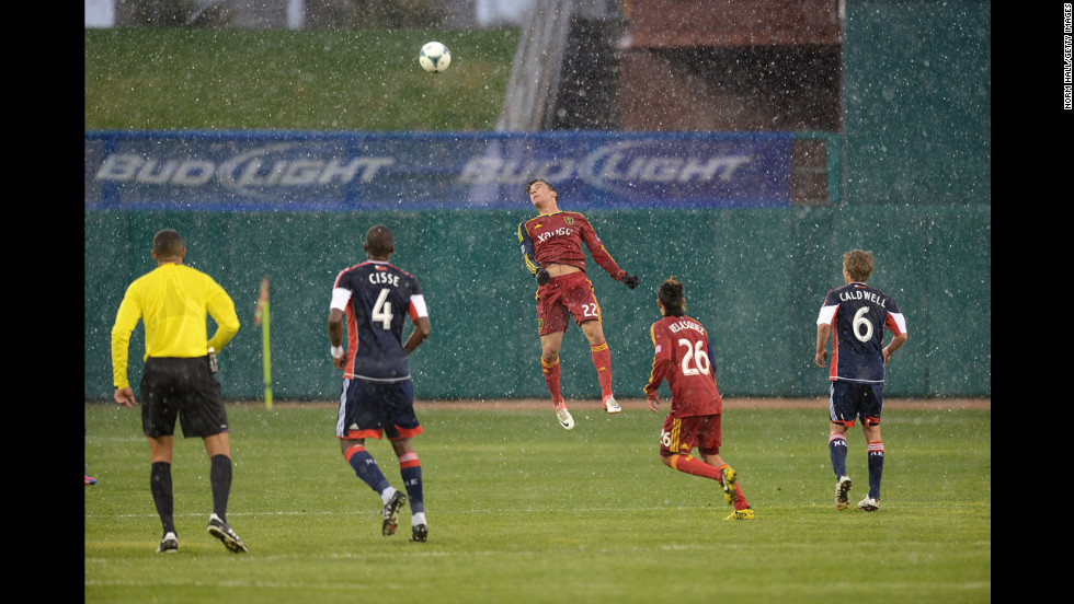 David Viana of the Real Salt Lake soccer team heads the ball against the New England Revolution during the snowfall on Wednesday in Tucson, Arizona.