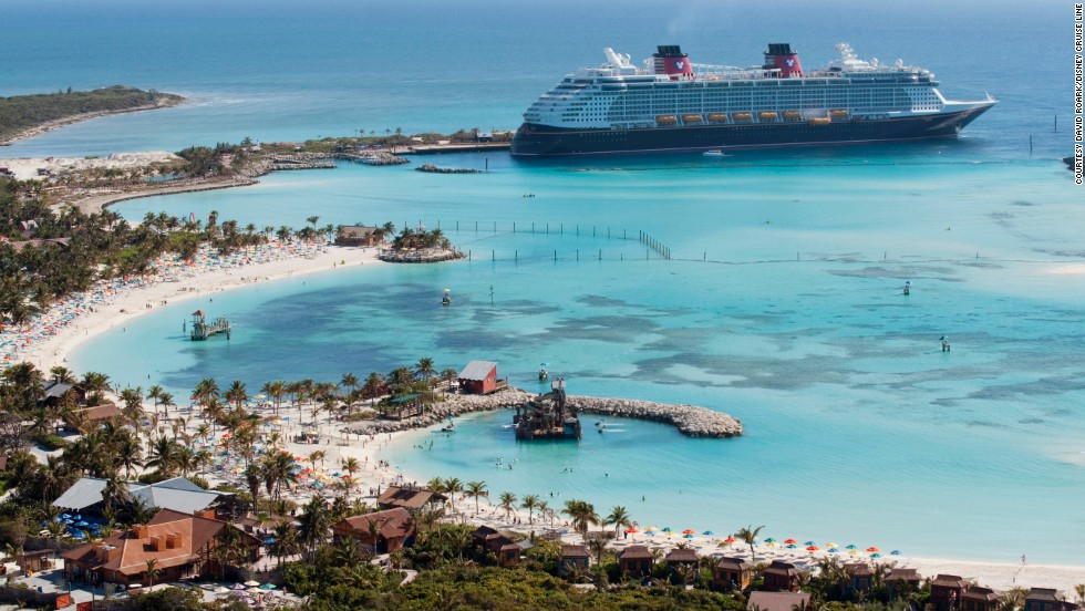 The Disney Dream is shown arriving at Castaway Cay, Disney's private island in the Bahamas.