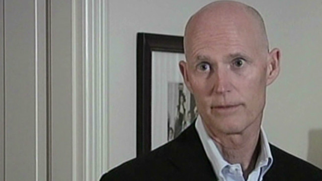 Florida governor reverses on Obamacare
